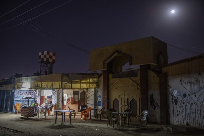 This Jan. 12, 2020 photo shows men drinking tea on a street just blocks away from the Khartoum Ophthalmology Hospital and a mosque where dozens of women were raped during the June 3, 2019 crackdown on a protest camp, in Khartoum, Sudan. The Associated Press spoke to six rape victims. They told similar stories of paramilitary fighters corralling up men and women who fled the protest site, beating them, sexually molesting the women and gang-raping some. By their accounts, the rapes took place in specific locations -- in a medical complex, a cemetery and the grounds of Khartoum University's mosque. (AP Photo/Nariman El-Mofty)