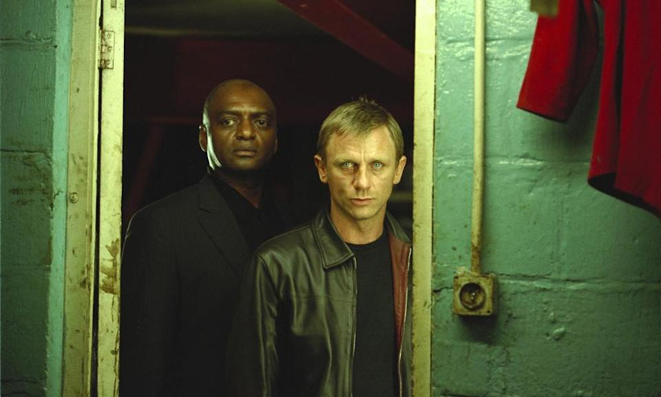 Morty (George Harris) and the unnamed protagonist (Daniel Craig) in Layer Cake