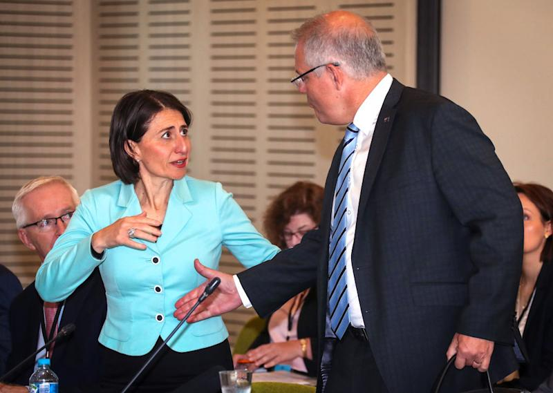 The Premier of New South Wales Gladys Berejiklian reacts as Australian Prime Minister Scott Morrison goes to shake her hand as he arrives at the Meeting of the Council of Australian Governments (COAG) at Parramatta Stadium.