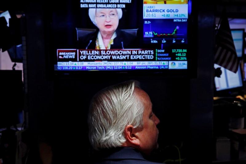 A trader watches Janet Yellen as he works on the floor of the NYSE