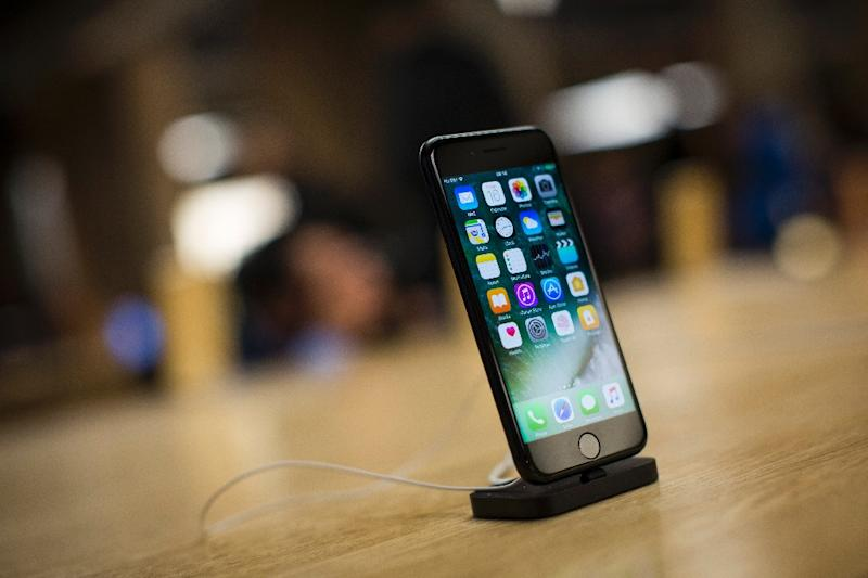 Apple has confirmed what critics long suspected: that it intentionally slows performance of older iPhones as their batteries weaken from age (AFP Photo/Jack Taylor)