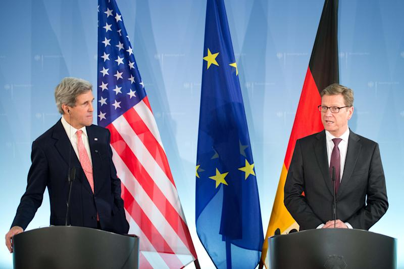 German foreign minister Guido Westerwelle ,right, gives a statement as US Secretary of State,John Kerry, left, listens at the Foreign Ministry in Berlin, Germany, Tuesday Feb, 26, 2013. (AP Photo/dpa, Maurizio Gambarin