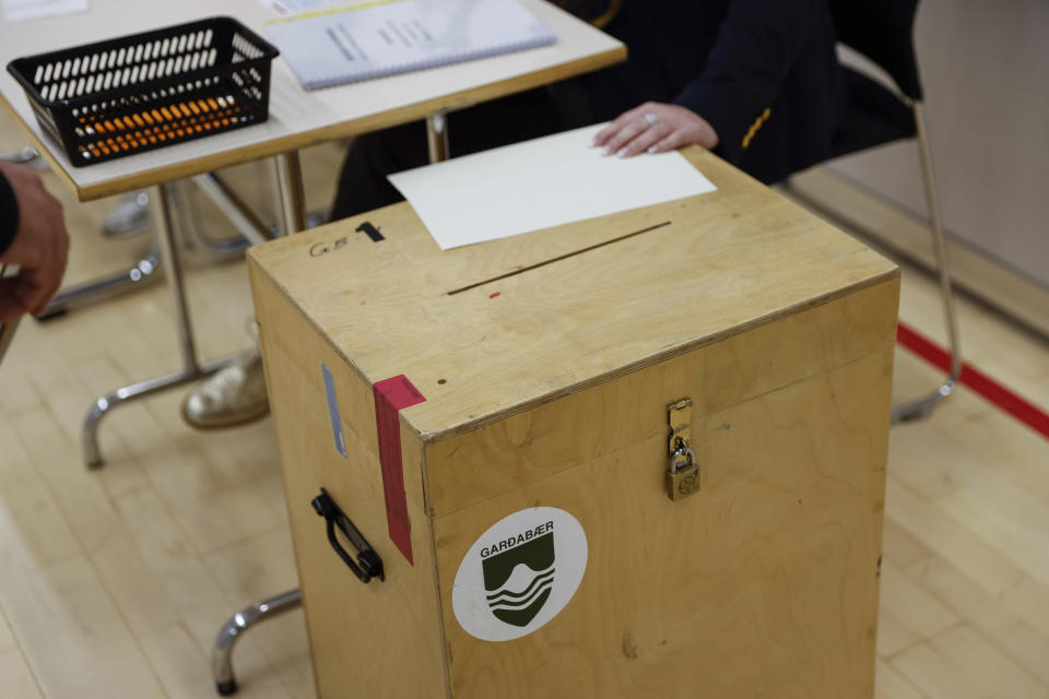 A vies of a Ballot box in a polling station in Gardabae, Iceland, Saturday, Sept. 25, 2021. Icelanders are voting in a general election dominated by climate change, with an unprecedented number of political parties likely to win parliamentary seats. Polls suggest there won't be an outright winner on Saturday, triggering complex negotiations to build a coalition government. (AP Photo/Brynjar Gunnarsson)