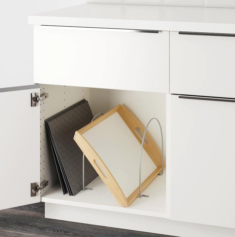 "<p>Keep your cupboards clutter-free with the help of the handy <a href=""https://www.popsugar.com/buy/Utrusta%20Partition-446972?p_name=Utrusta%20Partition&retailer=ikea.com&price=5&evar1=casa%3Aus&evar9=46151613&evar98=https%3A%2F%2Fwww.popsugar.com%2Fhome%2Fphoto-gallery%2F46151613%2Fimage%2F46152156%2FUtrusta-Partition&list1=shopping%2Cikea%2Corganization%2Ckitchens%2Chome%20shopping&prop13=api&pdata=1"" rel=""nofollow noopener"" target=""_blank"" data-ylk=""slk:Utrusta Partition"" class=""link rapid-noclick-resp"">Utrusta Partition</a> ($5).</p>"
