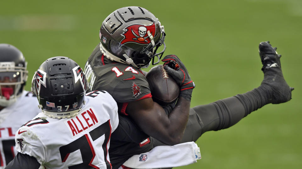 Tampa Bay Buccaneers wide receiver Chris Godwin (14) makes a catch in front of Atlanta Falcons free safety Ricardo Allen (37) during the second half of an NFL football game Sunday, Jan. 3, 2021, in Tampa, Fla. (AP Photo/Jason Behnken)