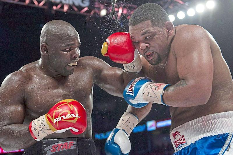 Powerhouse | Carlos Takam lands a left against Cuba's Mike Perez in 2014: Rex Features