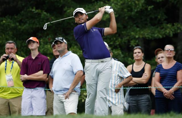 Jason Day tees off on the first hole during the third round of the Deutsche Bank Championship golf tournament in Norton, Mass., Sunday, Aug. 31, 2014. (AP Photo/Michael Dwyer)