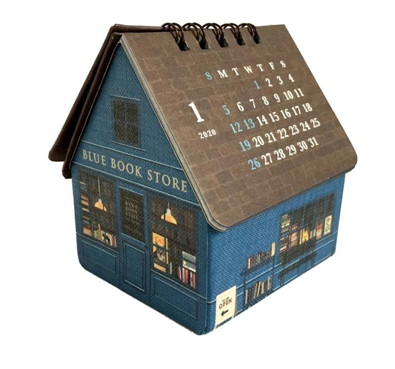 """This is the calendar that beats all calendars, because not only does it tell you the date, but you can store stuff (probably books, or maybe candy) inside it! <a href=""""https://www.curiosasociety.com/collections/holiday/products/2020housebookstoredeskcalendar"""" target=""""_blank"""" rel=""""noopener noreferrer"""">Get it for $17 at Curiosa.</a>"""