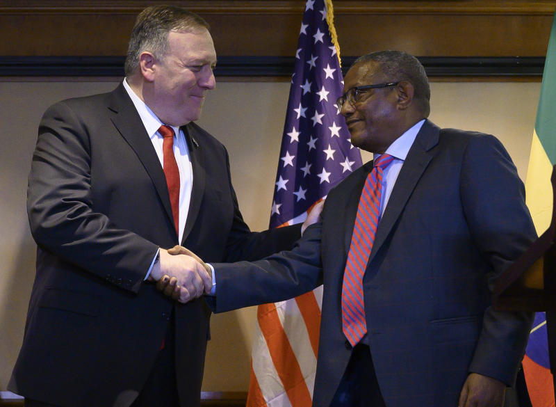 FILE - In this Tuesday, Feb. 18, 2020 file photo, U.S. Secretary of State Mike Pompeo, left, shakes hands with Ethiopia's Foreign Minister Gedu Andargachew, during a joint press conference at the Sheraton Hotel, in Addis Ababa, Ethiopia. In an interview with The Associated Press Friday, June 19, 2020, Ethiopia's Foreign Minister Gedu Andargachew declared that his country will go ahead and start filling the $4.6 billion Grand Ethiopian Renaissance Dam next month, even without an agreement with Egypt and Sudan. (Andrew Caballero-Reynolds/Pool Photo via AP, File)