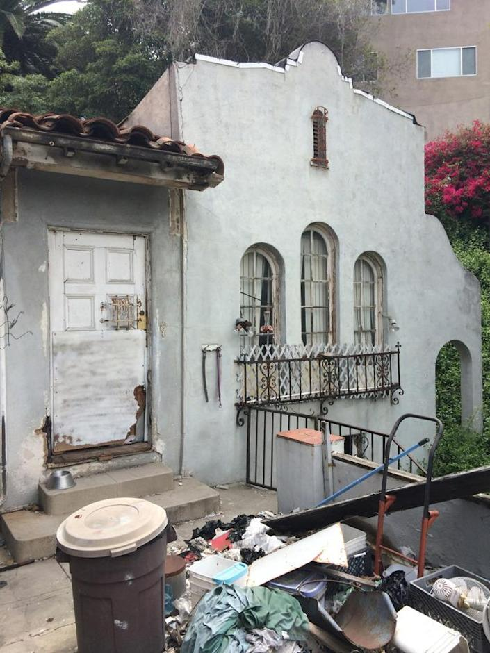"""<p>When Kenihan first spotted the house from outside, he didn't think it looked too bad. But once he got up close for a tour, he says, it was the worst condition he'd ever seen. The previous owner purchased the property for $16,000 in the 1960s, but the house had """"really become the eyesore of a beautiful neighborhood"""" since then, Kenihan says. <i>(Photo: Charmaine David for Kenihan Development)</i><br></p>"""