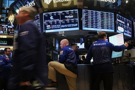 Dow closes above 14,000 for first time since 2007