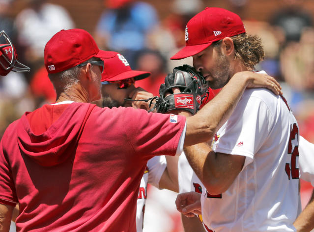 St. Louis Cardinals pitching coach Mike Maddux, left, talks with starting pitcher Michael Wacha during the third inning in the first game of a baseball doubleheader against the Kansas City Royals Wednesday, May 22, 2019, in St. Louis. (AP Photo/Jeff Roberson)