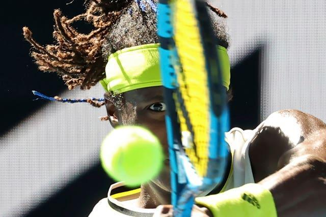 Swede Mikael Ymer keeps his eye on the ball during his defeat by Stefanos Tsitsipas