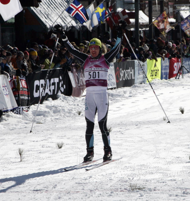 Caitlin Gregg, of Minneapolis, Minn., crosses the finish line at the American Birkebeiner, in Hayward, Wis., on Saturday, Feb. 22, 2014, in the women's skate division. Gregg had a time of 2:40:57.4. (AP Photo/Paul M. Walsh)