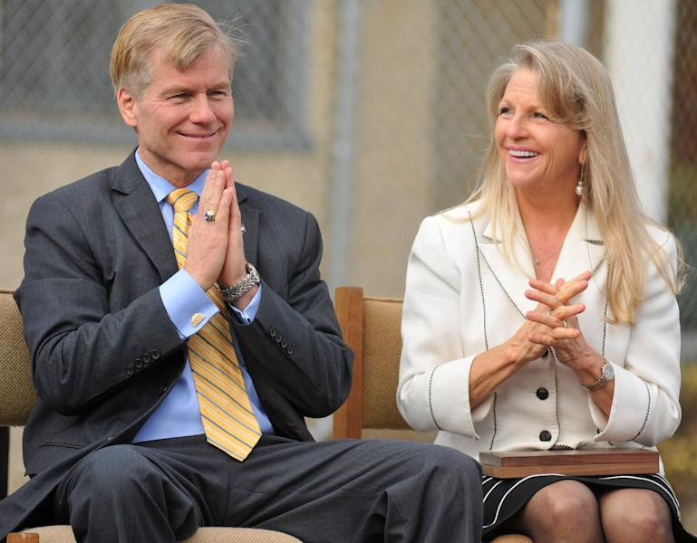 FILE - In this Oct. 22, 2013 file photo, then Virginia Gov. Bob McDonnell and First Lady Maureen McDonnell clasp their hands during an event at Saint Joseph School in Petersburg, Va. McDonnell and his wife were indicted Tuesday, Jan. 21, 2014, on corruption charges after a monthslong federal investigation into gifts the Republican received from a political donor. (AP Photo/The Progress-Index, Patrick Kane, File)