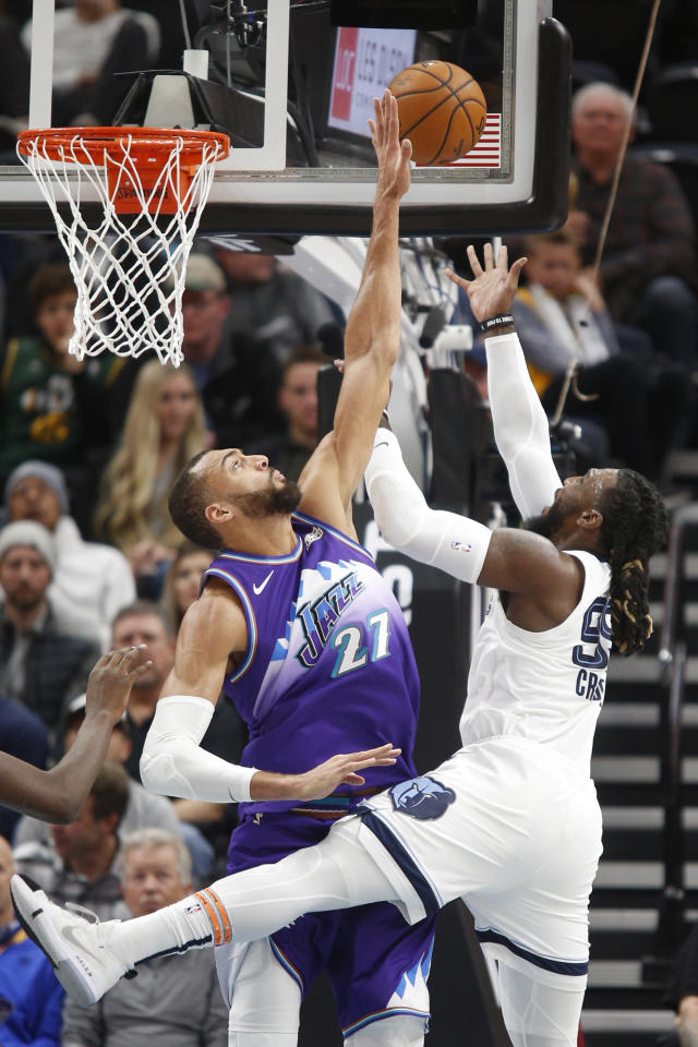 Utah Jazz center Rudy Gobert (27) challenges the shot of Memphis Grizzlies forward Jae Crowder (99) during the first half of an NBA basketball game Saturday, Dec. 7, 2019, in Salt Lake City. (AP Photo/George Frey)