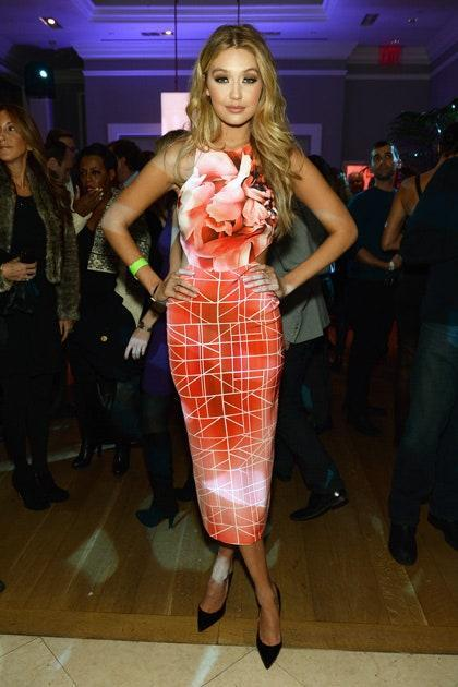 Gigi's foray into colorful eveningwear was nothing short of a grand success. The orangey-red hue of this dress makes her eyes pop, while its figure-hugging shape and eye-catching print signify she doesn't shy away from bold ensembles.