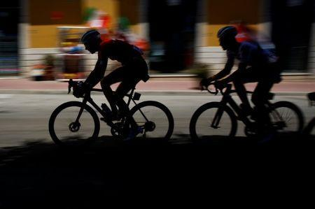 Cycling - the 101st Giro d'Italia cycling race - The 153-km Stage 5 from Agrigento to Santa Ninfa, Italy - May 9, 2018 - Riders are silhouetted during the 5th stage in Porto Empedocle, Italy. REUTERS/Tony Gentile