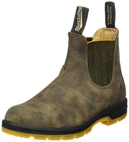 """<p><strong>Blundstone</strong></p><p>amazon.com</p><p><strong>$163.28</strong></p><p><a href=""""https://www.amazon.com/dp/B007DIXZOA?tag=syn-yahoo-20&ascsubtag=%5Bartid%7C10055.g.36292464%5Bsrc%7Cyahoo-us"""" rel=""""nofollow noopener"""" target=""""_blank"""" data-ylk=""""slk:Shop Now"""" class=""""link rapid-noclick-resp"""">Shop Now</a></p><p>While they're an initial investment, Blundstone boots are designed to last through every season. The outer leather is available in 15 different shades. Reviewers say that these are great work or travel boots, especially loving the <strong>pull tabs for easy on/off.</strong> Note that the size chart is a bit confusing as it includes men's and women's sizing, so be careful when ordering to ensure you get your correct size! </p>"""