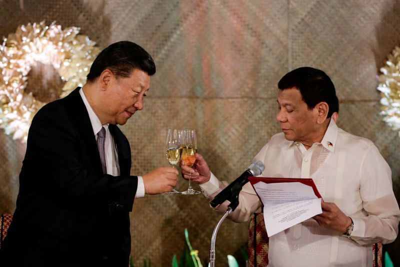 FILE PHOTO: China's President Xi Jinping and Philippine President Rodrigo Duterte toast during a State Banquet at the Malacanang presidential palace in Manila