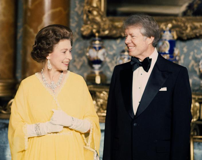 The Queen and Jimmy Carter in 1977 (PA)