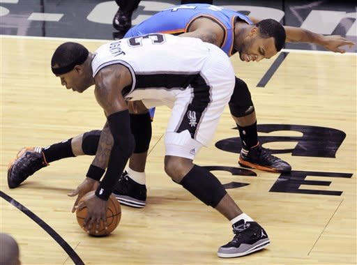 San Antonio Spurs shooting guard Stephen Jackson (3) and Oklahoma City Thunder shooting guard Daequan Cook (14) go after the ball during the first half of Game 5 in the NBA basketball Western Conference finals, Monday, June 4, 2012, in San Antonio. (AP Photo/Darren Abate)