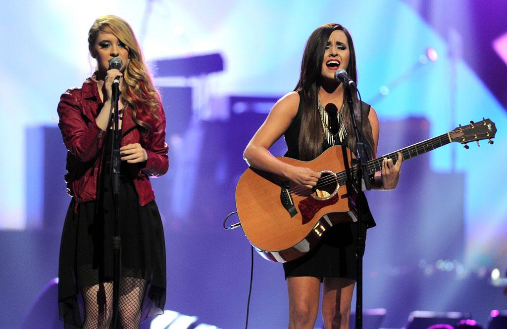 LAS VEGAS, NV - SEPTEMBER 21:  Singer/songwriters Megan Mace (L) and Liz Mace of Megan and Liz perform onstage during the 2012 iHeartRadio Music Festival at the MGM Grand Garden Arena on September 21, 2012 in Las Vegas, Nevada.  (Photo by Isaac Brekken/Getty Images for Clear Channel)