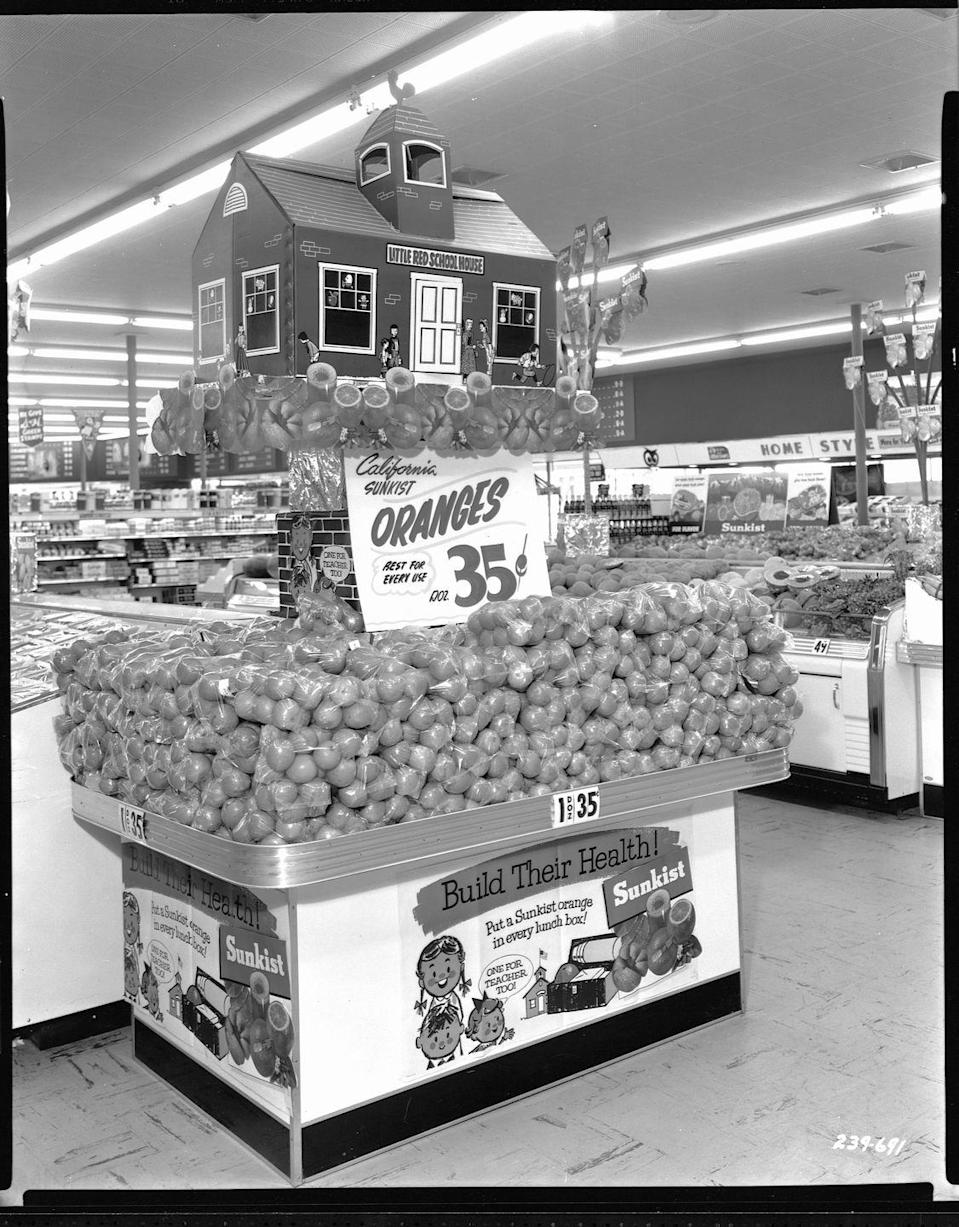 """<p>When the advertising industry was at its peak in the 1950s, grocery stores realized they could target their customers with <a href=""""https://dustyoldthing.com/grocery-store-nostalgia/"""" rel=""""nofollow noopener"""" target=""""_blank"""" data-ylk=""""slk:flashy displays"""" class=""""link rapid-noclick-resp"""">flashy displays</a> to push items. Stores used <a href=""""http://omgfacts.com/these-vintage-photos-show-the-history-of-the-supermarket/"""" rel=""""nofollow noopener"""" target=""""_blank"""" data-ylk=""""slk:elaborate displays, big wording and bright colors"""" class=""""link rapid-noclick-resp"""">elaborate displays, big wording and bright colors</a> to grab the attention of shoppers.</p>"""
