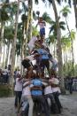 Surinamese men of mixed ethnic origins compete in the Indian folk sport called Makhan Chor (butter thief) during the Hindu Festival of Holi, known as the Festival of Colors, in Paramaribo, Suriname, March 17, 2014. Makhan Chor is played by forming a human pyramid with the lightest on top trying to grab a jar of butter hanging some 6 to 7 meters high. Makhan Chor is also one of the many names of the Hindu Lord Krishna who steals butter with his friends. REUTERS/Ranu Abhelakh (SURINAME - Tags: RELIGION SOCIETY)