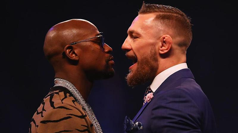 McGregor and Mayweather face off. Pic: Getty