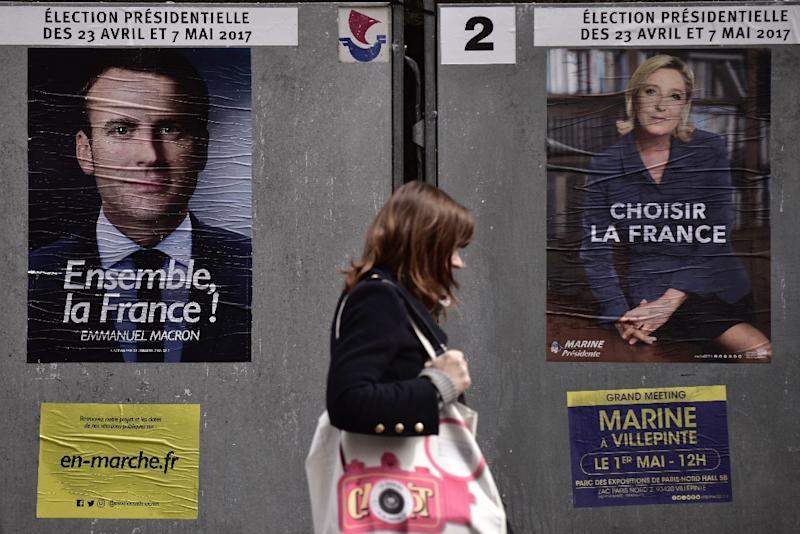 Pro-EU centrist Emmanuel Macron and far-right leader Marine Le Pen go head to head in the May 7 presidential election run-off (AFP Photo/Philippe LOPEZ)