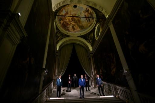 Models posing at  Venice's Scuola Grande di San Rocco showed off sharply tailored gear -- but the severe flooding in the city meant they could have done with rain boots too, creative director Filippo Ricci joked
