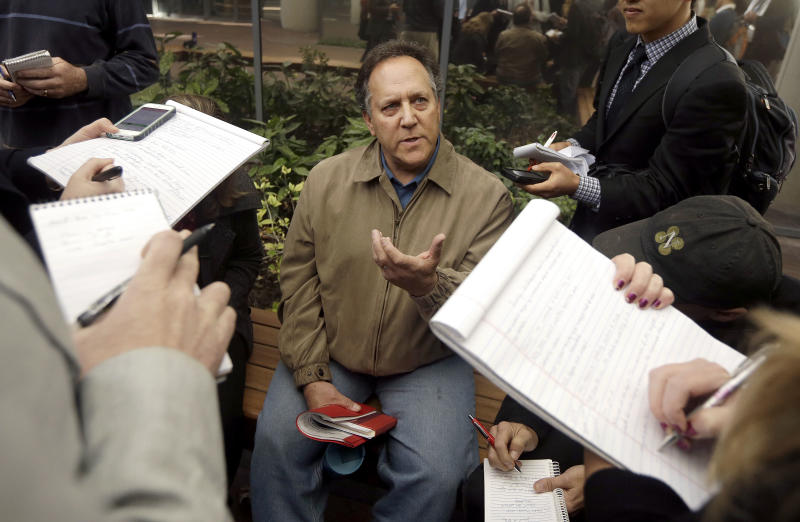 Juror Barry Goldman-Hall speaks to reporters outside of the federal building in San Jose, Calif., Thursday, Nov. 21, 2013. A Silicon Valley jury on Thursday ordered Samsung Electronics to pay Apple $290 million for copying vital iPhone and iPad features. The verdict covers 13 older Samsung devices that a previous jury found were among 26 Samsung products that infringed Apple patents. (AP Photo/Jeff Chiu)