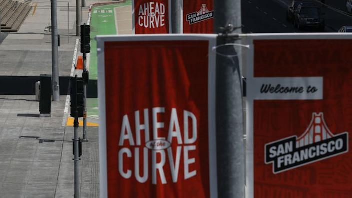 "Street banners in San Francisco boast that the city is ""ahead of the curve"" on dealing with Covid-19"