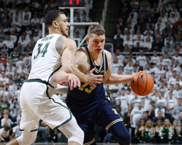 "Michigan's Mortiz Wagner, right, drives against Michigan State's <a class=""link rapid-noclick-resp"" href=""/ncaab/players/121499/"" data-ylk=""slk:Gavin Schilling"">Gavin Schilling</a> during the first half of an NCAA college basketball game, Saturday, Jan. 13, 2018, in East Lansing, Mich. Michigan won 82-72. (AP)"