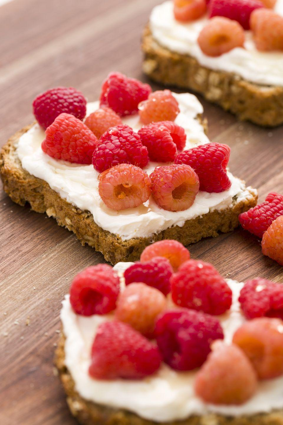 """<p>Sweetened ricotta is the perfect spread for toast. </p><p>Get the recipe from <a href=""""https://www.delish.com/cooking/recipe-ideas/recipes/a45367/ricotta-honey-toast-with-berries-recipe/"""" rel=""""nofollow noopener"""" target=""""_blank"""" data-ylk=""""slk:Delish"""" class=""""link rapid-noclick-resp"""">Delish</a>. </p>"""