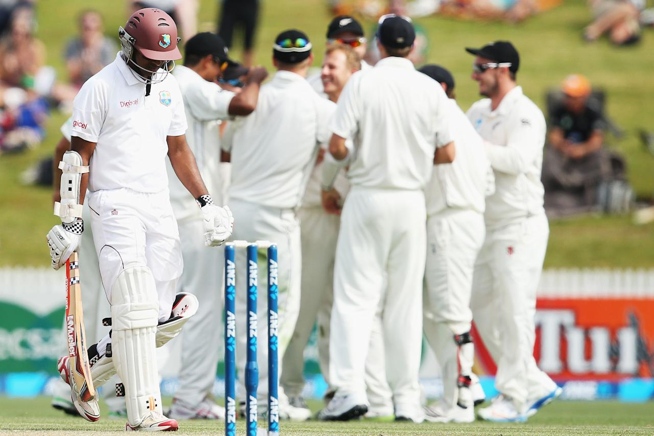 HAMILTON, NEW ZEALAND - DECEMBER 21: Shivnarine Chanderpaul of the West Indies walks off after being caught by Kane Williamson off the bowling of Neil Wagner of New Zealand to dismiss  during day three of the Third Test match between New Zealand and the West Indies at Seddon Park on December 21, 2013 in Hamilton, New Zealand.  (Photo by Hannah Johnston/Getty Images)