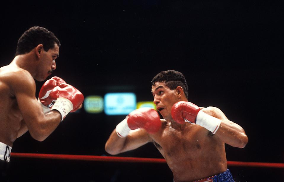 NEW YORK - JUNE 13,1986: Hector Camacho (R) looks to throw a punch to Edwin Rosario during the fight at Madison Square Garden in New York, New York. Hector Camacho won the WBC lightweight title by a SD 12.  (Photo by: The Ring Magazine via Getty Images)
