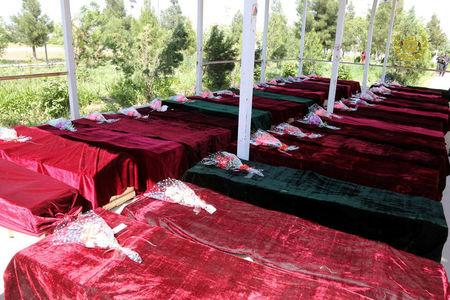 Coffins containing the bodies of Afghan national Army soldiers killed in April 21's attack on an army headquarters are lined up in Mazar-i-Sharif