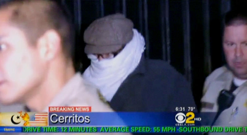 In this image from video provided by CBS2-KCAL9, Nakoula Basseley Nakoula, the man behind the anti-Muslim movie that has inflamed the Middle East, is escorted by Los Angeles County sheriff's deputies from his home, early Saturday, Sept. 15, 2012, in Cerritos, Calif.  Nakoula, 55, was interviewed by federal probation officers at a Los Angeles sheriff's station but was not arrested or detained, authorities said early Saturday. (AP Photo/CBS2-KCAL9) MANDATORY CREDIT CBS-KCAL9, LOS ANGELES OUT, LOS ANGELES TV OUT