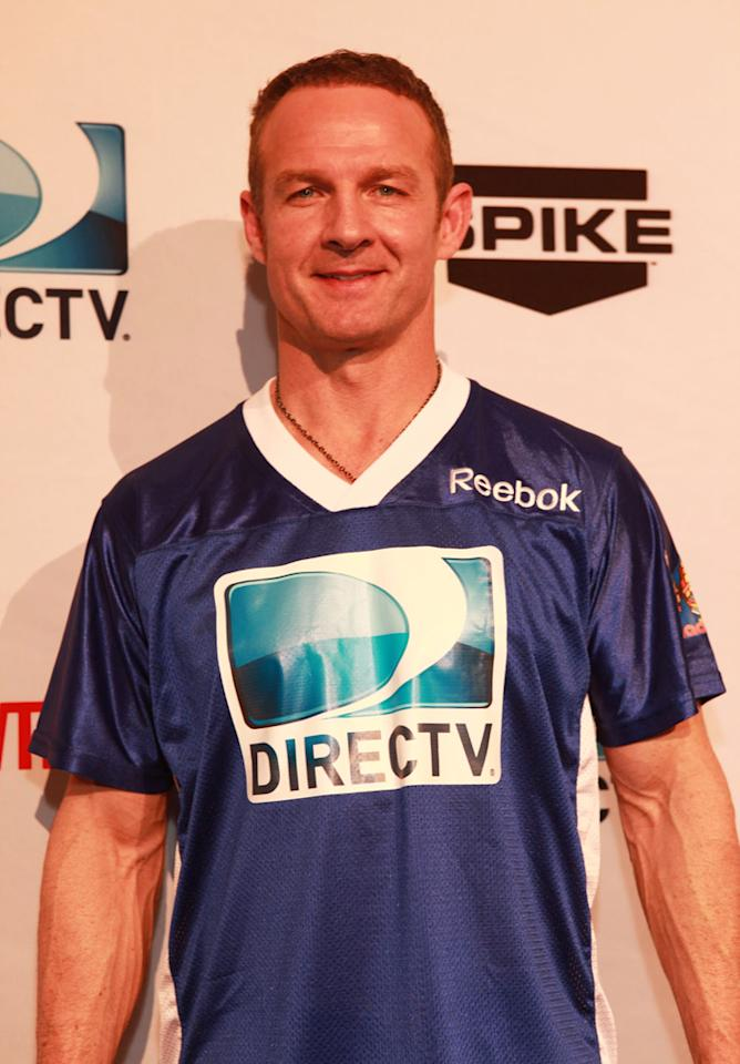 ESPN's Merril Hoge arrives at the DirecTV Celebrity Beach Bowl in Indianapolis.