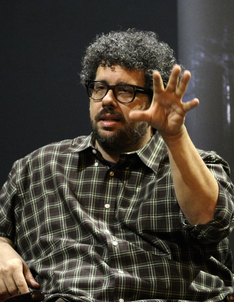 """FILE - This Nov. 22, 2010 file photo shows U.S. director, screenwriter and playwright, Neil LaBute  speaking at the Vaudeville theatre in London. LaBute's 10-minute, two person play """"In the Beginning,""""  that was among the highlights of the Edinburgh Fringe Festival last summer, will make it's American debut without having ever seen it.   (AP Photo/Sang Tan, file)"""