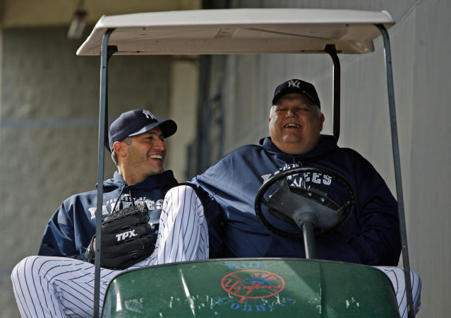 FILE - In this Feb. 19, 2010 file photo New York Yankees pitcher Andy Pettitte, left, laughs with Billy Connors, the Yankees vice president for player personnel, before pitchers and catchers worked out at Steinbrenner Field in Tampa, Fla. Connors, a three-time Yankees pitching coach and confidant of late owner George Steinbrenner, has died. He was 76. The Yankees said Wednesday, June 20, 2018 that Connors died Monday. (AP Photo/Kathy Willens, file)