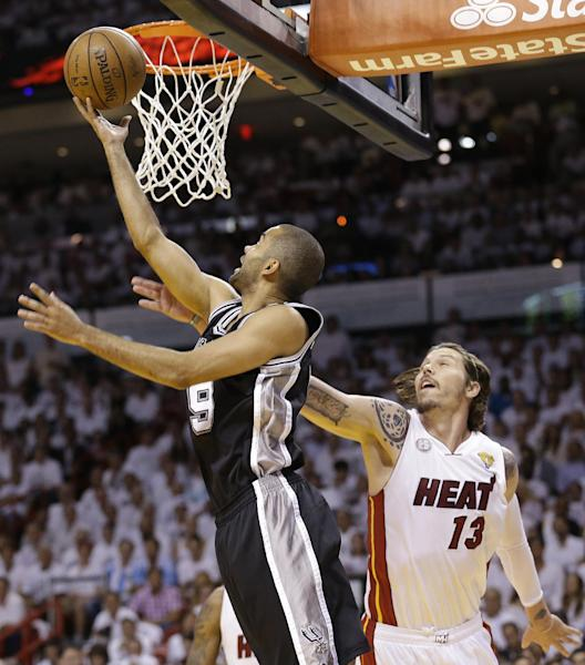 San Antonio Spurs' Tony Parker (9) shoots against the Miami Heat's Mike Miller (13) during the first half in Game 7 of the NBA basketball championships, Thursday, June 20, 2013, in Miami. (AP Photo/Lynne Sladky)