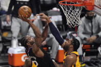 Los Angeles Clippers forward Kawhi Leonard, left, shoots as Utah Jazz center Derrick Favors defends during the first half in Game 4 of a second-round NBA basketball playoff series Monday, June 14, 2021, in Los Angeles. (AP Photo/Mark J. Terrill)