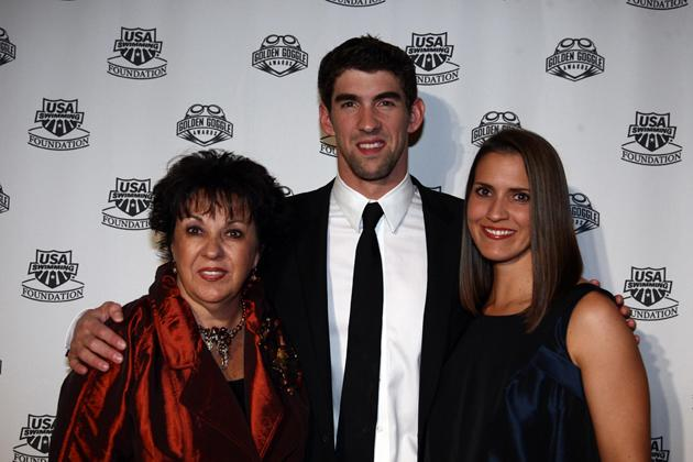 BEVERLY HILLS, CA - NOVEMBER 22:  Swimmer Michael Phelps poses with mom Debbie and sister Hilary during the 2009 USA Swimming Foundation Golden Goggles Awards on November 22, 2009 at the Beverly Hills Hilton in Beverly Hills, California. (Photo by Donald Miralle/Getty Images) 1 *** Local Caption *** Hilary Phelps;Debbie Phelps;Michael Phelps