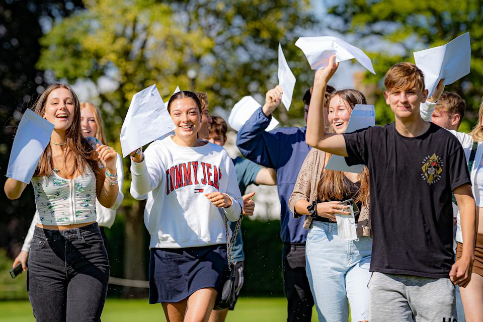 Students wave their A-Level exam results after collecting them at Taunton School in Somerset. Picture date: Tuesday August 10, 2021.