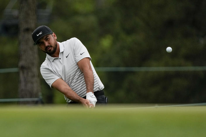 Jason Day, of Australia, chips to the green on the 17th hole during the second round of the Masters golf tournament on Friday, April 9, 2021, in Augusta, Ga. (AP Photo/Gregory Bull)