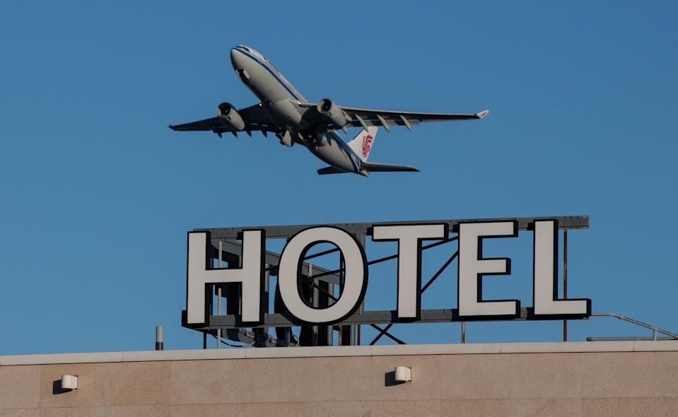 An airplane passes over a Sofitel hotel as it takes off from a runway at Heathrow AirportGetty Images