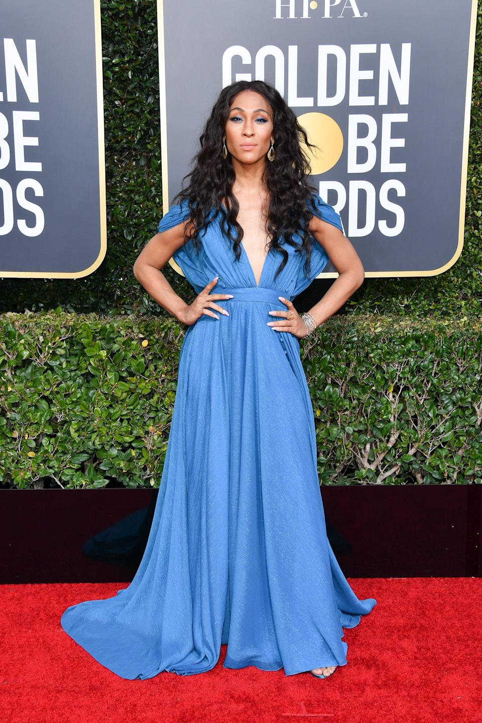 <p>Mj coordinated this indigo gown with Kallati jewels and Stuart Weitzman shoes at the 2019 Golden Globe Awards.</p>